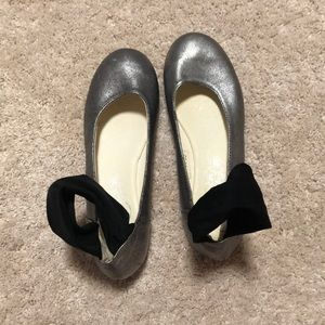 silver flats with black ankle band